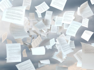 tax papers falling on a cloud sky background